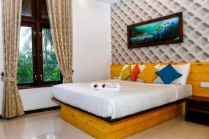 A bed or beds in a room at Hotel Bella Vista
