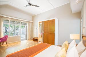 A bed or beds in a room at Ellaidhoo Maldives by Cinnamon