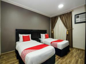 Cama ou camas em um quarto em Yahalla Hotel Units 2