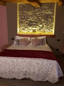 A bed or beds in a room at Agriturismo Rivet d'Or