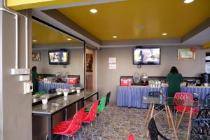ห้องอาหารหรือที่รับประทานอาหารของ Berich Hotel