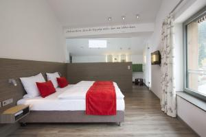 A bed or beds in a room at Hotel Traube Tonbach