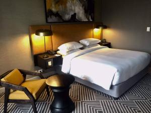 A bed or beds in a room at Hilton Addis Ababa