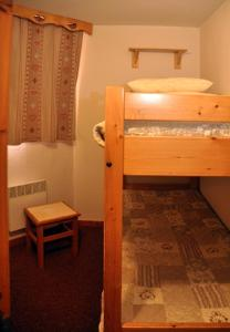 A bunk bed or bunk beds in a room at Les Melezets 1