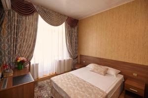 Кровать или кровати в номере Гостиница Центральная