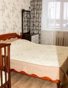 Кровать или кровати в номере Трехкомнатные апартаменты на Гоголя