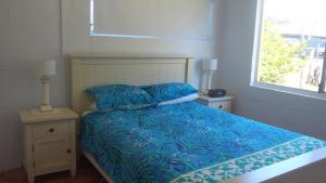 A bed or beds in a room at Beach House in Mylestom