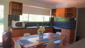 A kitchen or kitchenette at Beach House in Mylestom
