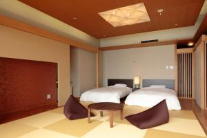 A bed or beds in a room at Kikusuitei