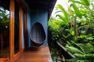 A balcony or terrace at Ipoh Bali Hotel