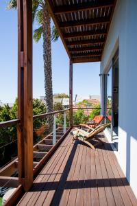 A balcony or terrace at The One 8 Hotel - Three Anchor Bay Cape Town