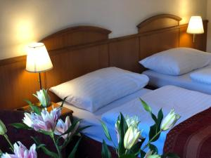 A bed or beds in a room at Kavalir