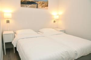 Een bed of bedden in een kamer bij Residence Le Mistral