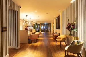 De lounge of bar bij Monet Garden Hotel Amsterdam