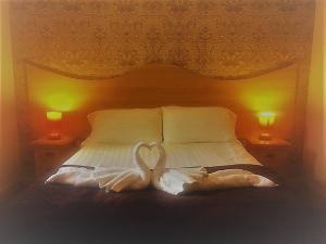 Letto o letti in una camera di Dunamoy Cottages & Spa
