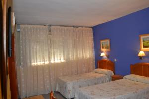 Cama o camas de una habitación en Hostal Al-Qazeres