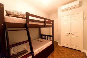 A bunk bed or bunk beds in a room at The Only Backpacker's Inn