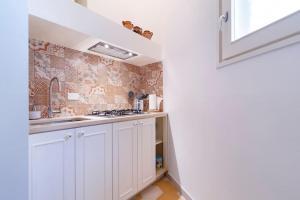 Cucina o angolo cottura di Li Frati Casa Vacanze