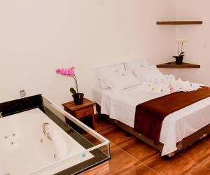 Cama ou camas em um quarto em Pousada Morada Do Sol