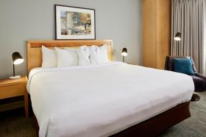 A bed or beds in a room at Inn at the Forks