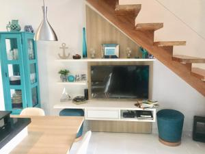 A television and/or entertainment centre at Cozy Blue House