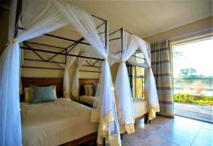 A bed or beds in a room at The Waterfront, Maun