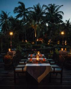 A restaurant or other place to eat at Bo Phut Resort and Spa - SHA Plus