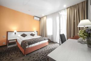 Кровать или кровати в номере Кремниевы Термы Спа-комплекс