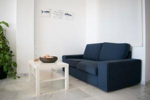 A seating area at Apartamentos Turísticos Resort de Nerja