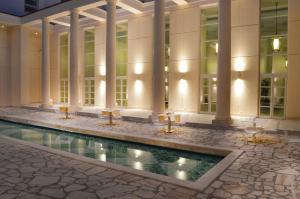 The swimming pool at or close to Palazzo Esedra