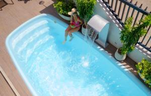 The swimming pool at or near Pousada Encantare