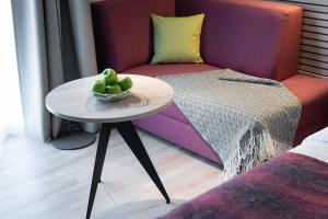 A bed or beds in a room at Citadines Arnulfpark Munich