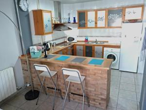 A kitchen or kitchenette at Piso La Torre