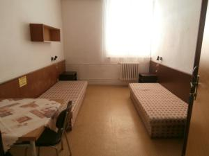 Postel nebo postele na pokoji v ubytování Ubytovna TJ Ostrava