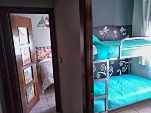 A bunk bed or bunk beds in a room at Piso La Torre