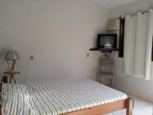 Cama ou camas em um quarto em Casa Colibri