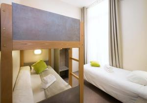 A bed or beds in a room at Residence La Canebiere