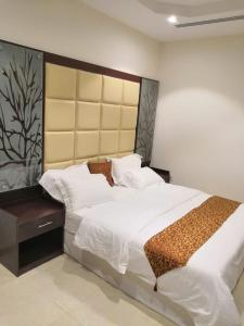 Cama ou camas em um quarto em Masaken Alyasmin