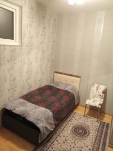 Cama ou camas em um quarto em Orkhan's Guest House