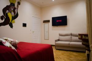 A television and/or entertainment centre at B&B Sosta Flegrea