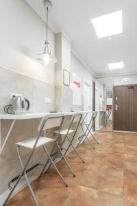 A kitchen or kitchenette at Babel Hostel