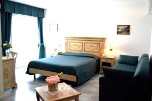 Postel nebo postele na pokoji v ubytování Hotel Oasi