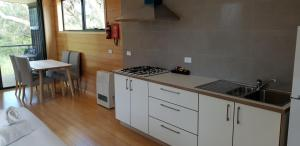 A kitchen or kitchenette at Bimbi Park - Camping Under Koalas
