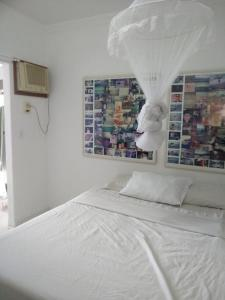 A bed or beds in a room at Casa Frente Praia Porto Seguro