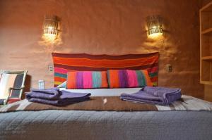 A bed or beds in a room at Ckuri Atacama