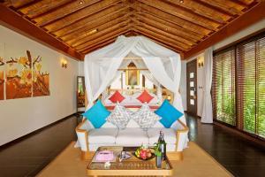 A bed or beds in a room at Amiana Resort Nha Trang