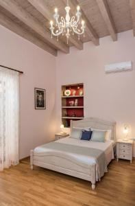 A bed or beds in a room at Palazzo di Irene