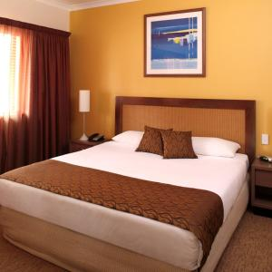 A bed or beds in a room at Mantra Geraldton
