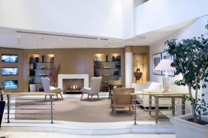 The lobby or reception area at Golden Age Athens Hotel