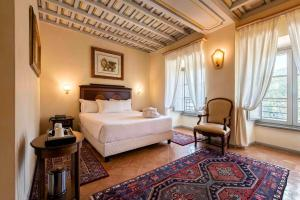A bed or beds in a room at Hotel Terme di Stigliano